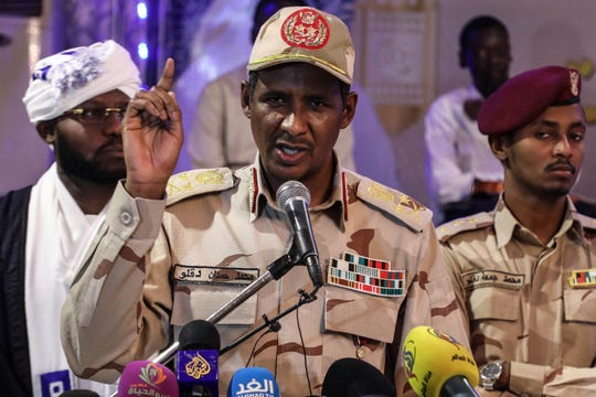 In this May 18, 2019 file photo, Gen. Mohammed Hamdan Dagalo, the deputy head of the military council that assumed power in Sudan after the overthrow of President Omar al-Bashir, speaks to journalists in Khartoum, Sudan.