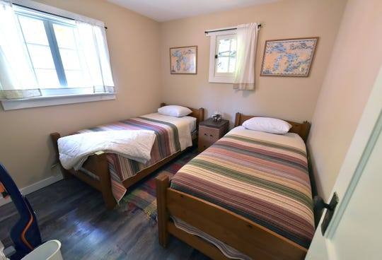 Cabin #3 at the Paradise Pines Resort features twin beds a master bedroom and updated fixtures and amenitites.