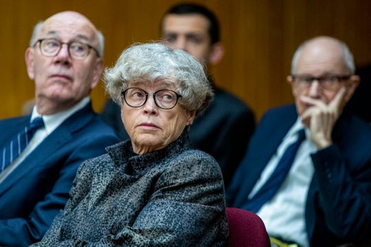 Ex-Michigan State University president Lou Anna Simon, center, listens during a preliminary hearing at the Eaton County Courthouse in Charlotte, June 11, 2019.