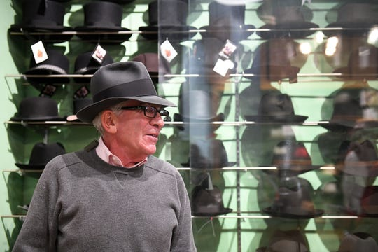 At 72, Henry the Hatter owner Paul Wasserman, above, is slowly selling out to 34-year employee Joe Renkiewicz after a move from downtown to Eastern Market.