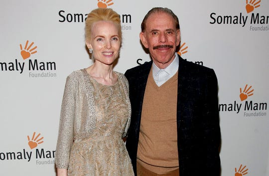 In this Oct. 23, 2013, file photo, artist Peter Max, right, and his wife Mary Max, left, attend the Somaly Mam Foundation Gala in New York.