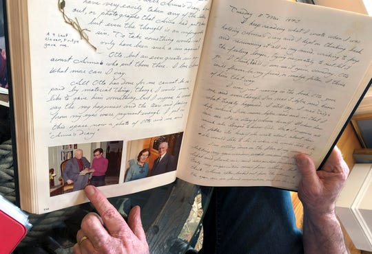 Ryan Cooper displays pages from a 1973 portion of a diary at his home in Yarmouth, Mass., which he wrote when he visited Otto Frank, the father of the famed Holocaust victim and diarist Anne Frank.