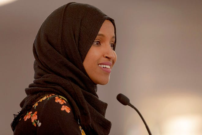In this May 18, 2019 file photo, Rep. Ilhan Omar, D-Minn., speaks during the fourth annual Citywide Iftar Dinner in Austin, Texas. A campaign finance investigation found that Omar filed joint tax returns with her husband before they were legally married. The Minnesota Campaign Finance and Public Disclosure Board says Omar and her husband filed joint tax returns for 2014 and 2015. They weren't married until 2018. Omar's campaign says all of her filings are fully complaint with applicable tax law.