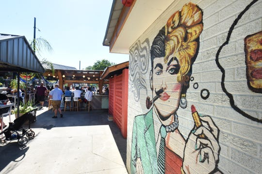 The improved patio showcases a gender-bending mural at Como's in Ferndale.