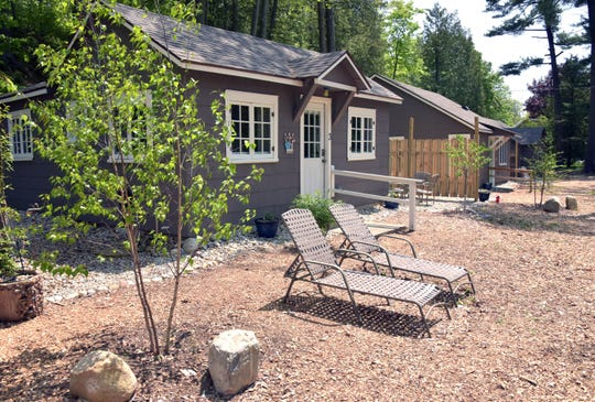 The Paradise Pines Resort, with three restored cabins, has re-opened a mile south of the village of Elk Rapids, Michigan.