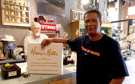 """Duane Hines of Superior Township picked up a cream fedora and a blue pork pie at the store. """"Henry the Hatter, man. It's a statement,"""" he says. """"They represent the city of Detroit."""""""