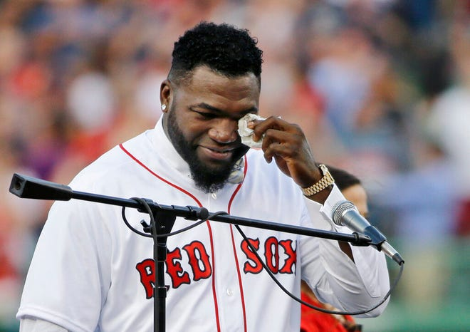 """In this June 23, 2017, file photo, Boston Red Sox baseball great David Ortiz wipes a tear at Fenway Park in Boston as the team retires his number """"34"""" worn when he led the franchise to three World Series titles. Ortiz was back in Boston for medical care after authorities said the former Red Sox slugger affectionately known as Big Papi was ambushed by a gunman at a bar in his native Dominican Republic."""