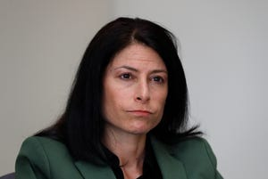 In this June 4, 2019, photo, Dana Nessel, Attorney General of Michigan, listens to a question from reporters in Detroit.
