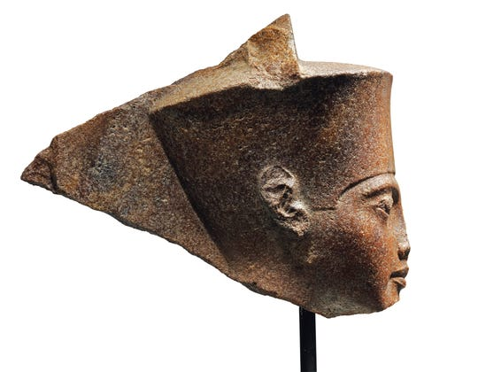 This image released by Christie's on Tuesday, June 11, 2019, shows a 3,000-year-old stone sculpture of the famed boy pharaoh Tutankhamun at Christie's in London.