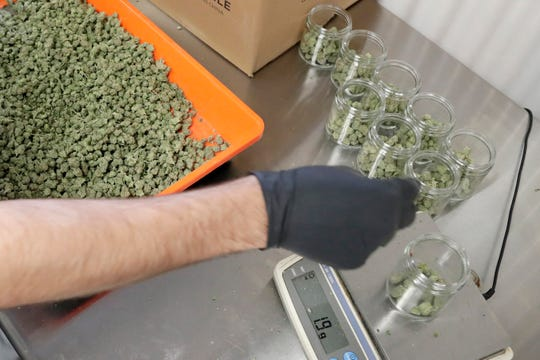 An employee at a medical marijuana dispensary in Egg Harbor Township, N.J., sorts buds into prescription bottles. At the end of 2018, about 1.4 million Americans are actively using marijuana to treat anxiety, sleep apnea and cancer.