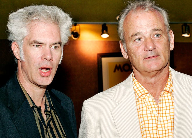 """In this July 27, 2005 file photo, actor Bill Murray, right, stands with film director Jim Jarmusch, left, at the premiere of """"Broken Flowers,"""" in New York. Murray and Jarmusch have made three films together, starting with the 2003 black-and-white vignette anthology """"Coffee and Cigarettes"""" and followed by the 2005 drama """"Broken Flowers,"""" a high point for both, in which Murray played """"an over-the-hill Don Juan."""" They've now reunited again in """"The Dead Don't Die,"""" Jarmusch's wry but impassioned zombie tale."""