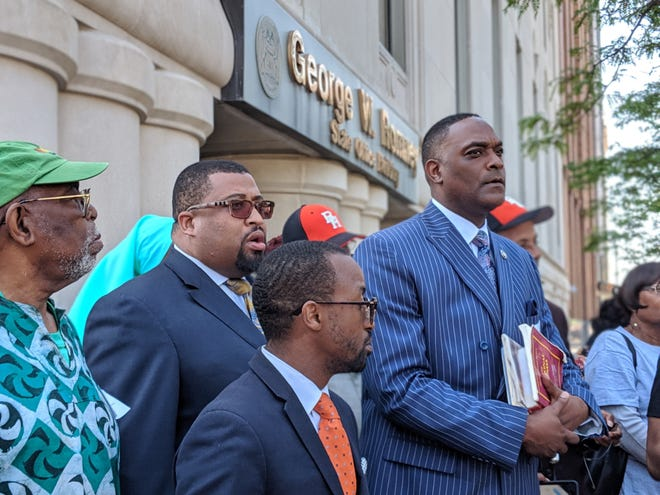 Benton Harbor Mayor Marcus Muhammad, right, and other activists rally outside Gov. Gretchen Whitmer's office on June 11, 2019.