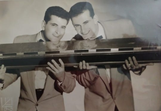 Tony, left, and Dom Sgro in 1956 with their 6-foot, 40-pound harmonica, custom-made for them.