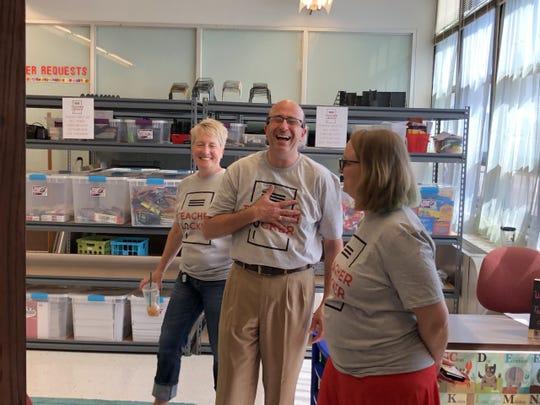 Teacher Locker volunteers and EVSC Foundation Treasurer Jeffrey Berger share laughs during the unveiling of the Teacher Locker.