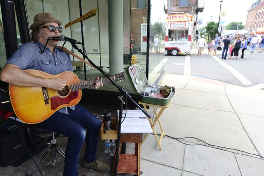 Brent Kirby of Cleveland performs at the Downtown Fremont Farmers Market in June 2018. This year's first farmers market of the season is Saturday on Front Street.