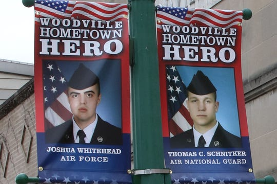 "Woodville banners honor ""Hometown Heroes"" including Joshua Whitehead and Thomas Schnitker."