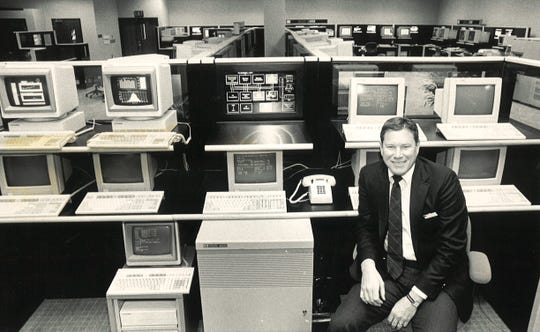 Bill Parzybok, then general manager of Hewlett-Packard's Engineering and Manufacturing Systems Group, is pictured in 1988 in what was then a new Demonstration Center at the Fort Collins plant. The center allowed customers to test and inspect computers and systems.