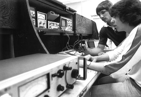 Voc-Tech Electronics Technology students Dwayne Irwin, foreground, and John Lecheler learn on recently donated equipment from HP in this file photo from 1980.