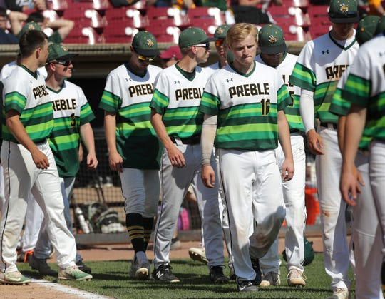 Green Bay Preble walks off the field after its 3-0 quarterfinal loss to Burlington at the WIAA state baseball tournament Tuesday at Fox Cities Stadium in Grand Chute. The Hornets finished 24-4.