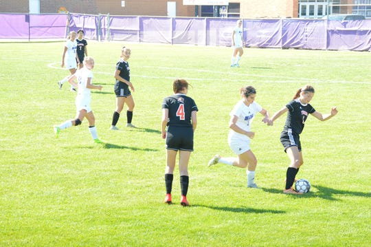 Marshfield's Paige Preston, right, works the ball during a recent match.
