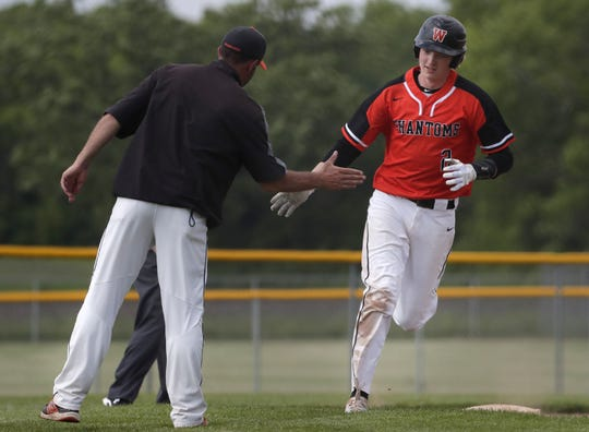 West De Pere's Cameron Dupont celebrates hitting a two-run home run against Seymour during sectional play last week.