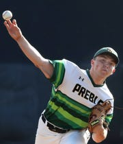 Green Bay Preble's Max Wagner delivers a pitch during Tuesday's WIAA Division 1 state baseball quarterfinal matchup against Burlington at Fox Cities Stadium in Grand Chute.
