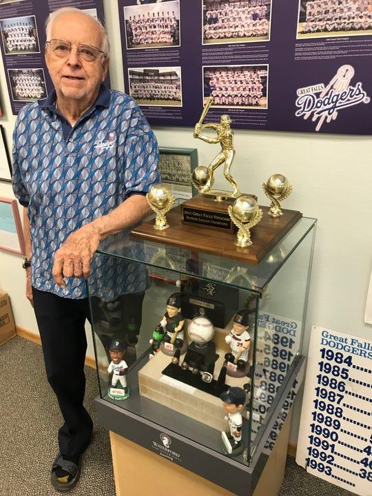 Jim Eakland, the historian of the Great Falls Baseball Club, poses in the Logan Hurlbert Hall of Fame Room at Centene Stadium.