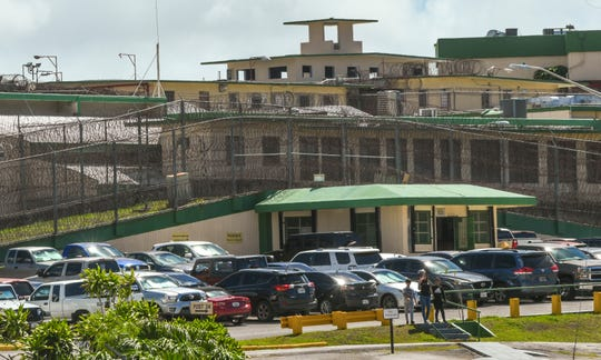 Visitors walk toward the Visitors Control Center at the Department of Corrections compound in Mangilao in this June 11 file photo.