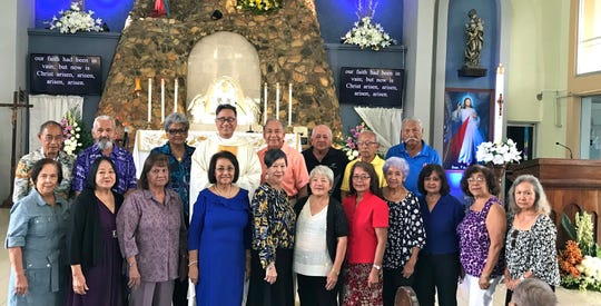 The George Washington High School Class of 1962 celebrated their 57th year since graduation by attending mass officiated by Father Paul Gofigan at Our Lady of Lourdes Church in Yigo on June 2. Front row from left: Judy Perez, Maria Acfalle, Fely Sablan, Gloria Flores, Marietta Camacho, Rosita Taitague, Trini Chargualaf, Margaret Hildebrande, Dorothy Perez, Terry Contreras, and Virginia Shimizu. Back row from left: Felix Babauta, Felix Santos, Rita Salas, Fr. Paul, Pete Babauta, David Afaisen, Frank Perez, and Woody Concepcion. Mass was followed by brunch at the Fiesta Resort where classmates Julie Cabales and Maria Pablo (not shown) joined the group.