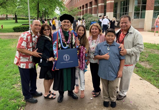 Ryan Santos graduated from A.T. Still University's Kirksville College of Osteopathic Medicine in Kirksville, Missouri on May 18. Santos of Santa Rita attended Notre Dame High School and Chaminade University of Honolulu before enrolling at ATSU-KCOM. He is the son of Ricardo and Helen Santos, son-in-law of Felix and Celia Dydasco and grandson of Ricardo and Rose Santos of Santa Rita and Ben Luzano of Agana Heights. He is married to Querida Dydasco Santos. He will begin his residency at Tripler Army Medical Center in Honolulu, Hawaii in June. Pictured from left: Ricardo Santos, Helen Santos, Ryan Mathew Luzano Santos, Querida Santos, Celia Dydasco, Aiden Dydasco, and Felix Dydasco