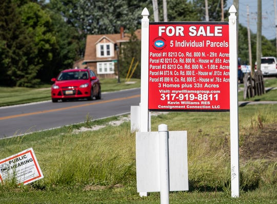"A ""for sale"" sign stands near farmland off of E. County Road 100 N. near Dan Jones Road in Avon."