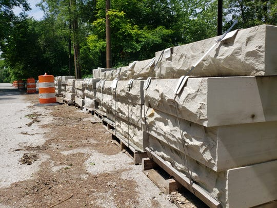 The sandstone used to reconstruct the Central Avenue bridge over Fall Creek is spread out on Fall Creek Parkway South.
