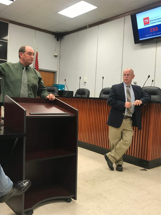 Tennessee Department of Environment and Conservation officials Chuck Head (left) and Robert Wilkinson talk to Anderson County residents about coal ash concerns during a public meeting June 10, 2019.
