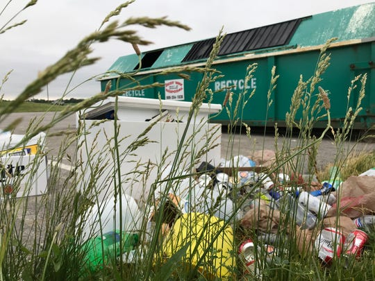 Recycling and trash piles up near a recycling bin at Southwestern Middle School on Tippecanoe County Road 800 South on Monday, June 10, 2019. Drop-off recycling sites in rural Tippecanoe County have been under more pressure  in the past month since West Lafayette closed a drop-off center in May.