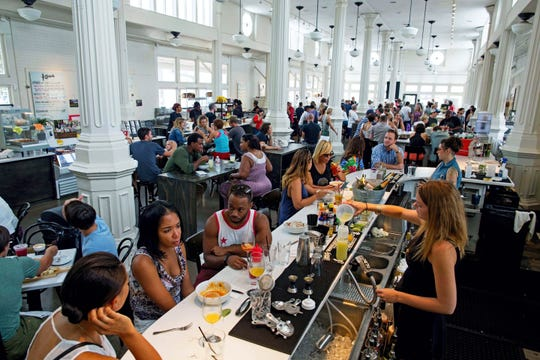 St. Roch Market in New Orleans is a successful food hall and tourist attraction hosting multiple upscale dining concepts.