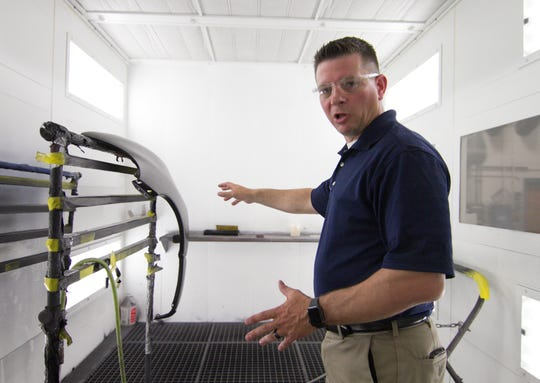 Chris Hoeh, vice president of operations at Transtar Autobody Technologies, Inc., talks about the small   spray booth used for testing product at the Genoa Township facility Tuesday, June 11, 2019.