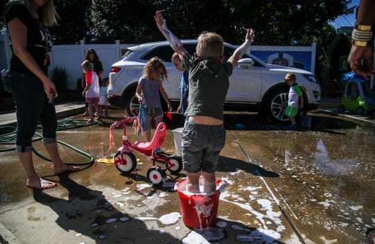 Children play while learning about how to wash a car at The Visually Impaired Preschool Services on Goldsmith Lane recently. The school has settings that introduce everyday life such as a crosswalk, street signs, store fronts as well as settings that resemble a grocery store or library. The school faces a loss of funding due to budget cuts. June 11, 2019