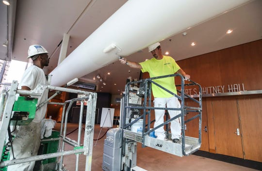 Tilman Jones, left, and Lester Butler, right, of Chambers Painting work on putting a new coat of paint on ductwork inside the Kentucky Center for the Arts recently. The work was being done after fire and smoke heavily damaged the center in 2018. June 10, 2019.