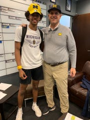 East Lansing receiver Andrel Anthony Jr. poses for a picture with Michigan football coach Jim Harbaugh on Saturday, June 8, 2019, in Ann Arbor. Anthony, who is in the 2021 class, has received an offer to play football at U-M.