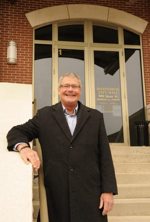 FILE - Kevin Crawford served Manitowoc as mayor for 20 years. He's shown here outside City Hall in April 2014.