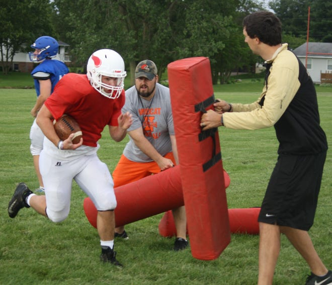 Plymouth running back Kade Collins takes part in a drill during the North all-stars practice session Monday at Shelby High School.