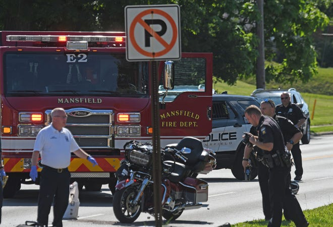 Mansfield police and fire departments work the scene of a fatal crash on Park Avenue West on Tuesday evening.