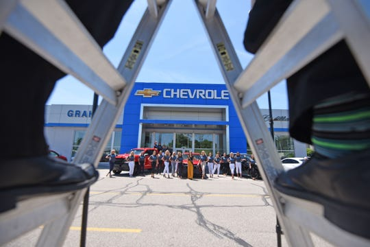 The 2019 Miss Ohio Contestants pose for a photo outside Graham Chevrolet on Tuesday morning. Graham leases the Miss Ohio Scholarship Program the use of a Chevy Cruze for a year during the winner's reign.
