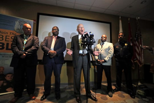 Executive Director of Crimestoppers Buddy Chapman, center, speaks during a press conference discussing the murder of Glenn Cofield, a well-known Memphis businessman, and the reward for information about the details leading to his death.