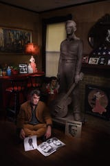 Artist Mike McCarthy, in the living room of his Cooper-Young home, with the clay Johnny Cash sculpture that would be the basis of the bronze statue set to be unveiled June 12.