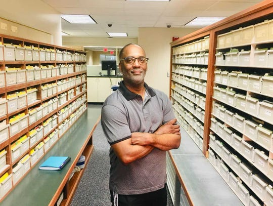Historian Reggie Jackson in the Milwaukee County Register of Deeds office, where he researches the racially restrictive clauses that frequently appeared in property deeds in the last century, laying the foundations for the city's status as America's most racially segregated city