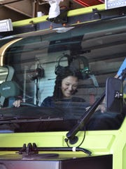 Kylie Miller, a recent graduate of Ronald Reagan High School, sits in a fire truck at Milwaukee Mitchell International Airport's Fire and Rescue.