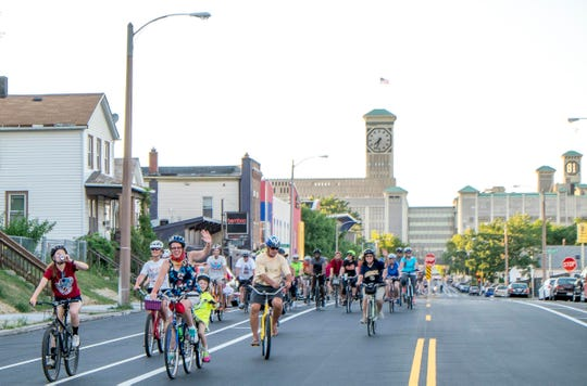 Cyclists ride near the Rockwell Automation (formerly Allen-Bradley) Clock Tower on Milwaukee's south side during a past Polish Moon Ride.
