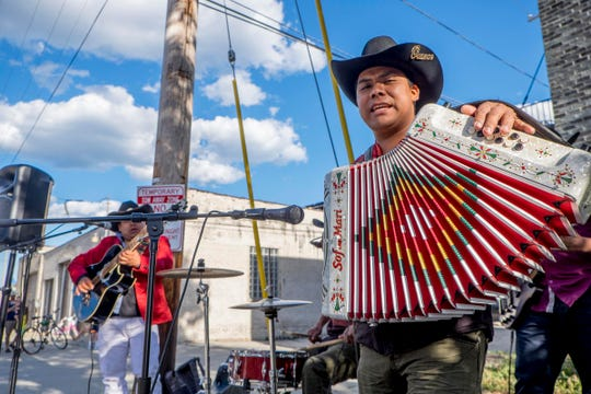 Musicians perform nortena music during a past Polish Moon ride on Milwaukee's south side.