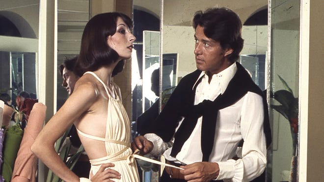 "That's Anjelica Huston being styled by Halston, in a scene from the documentary about the designer, ""Halston."""